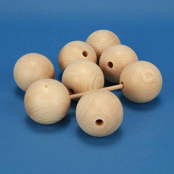 Sphères en bois Ø 60mm demi percés 10mm